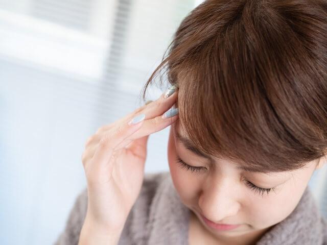頭痛餅の女性
