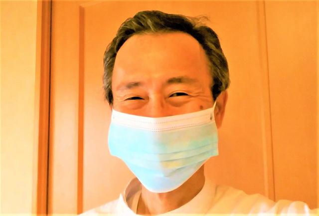 マスクをした院長
